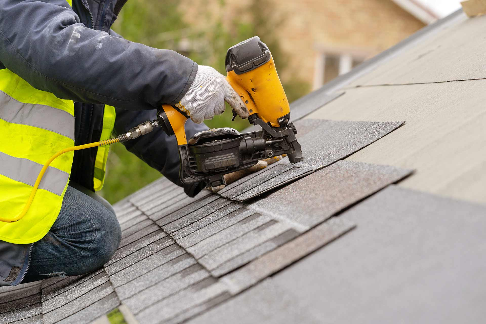 Roof repair worker replacing shingles on a home in Plant City, FL.