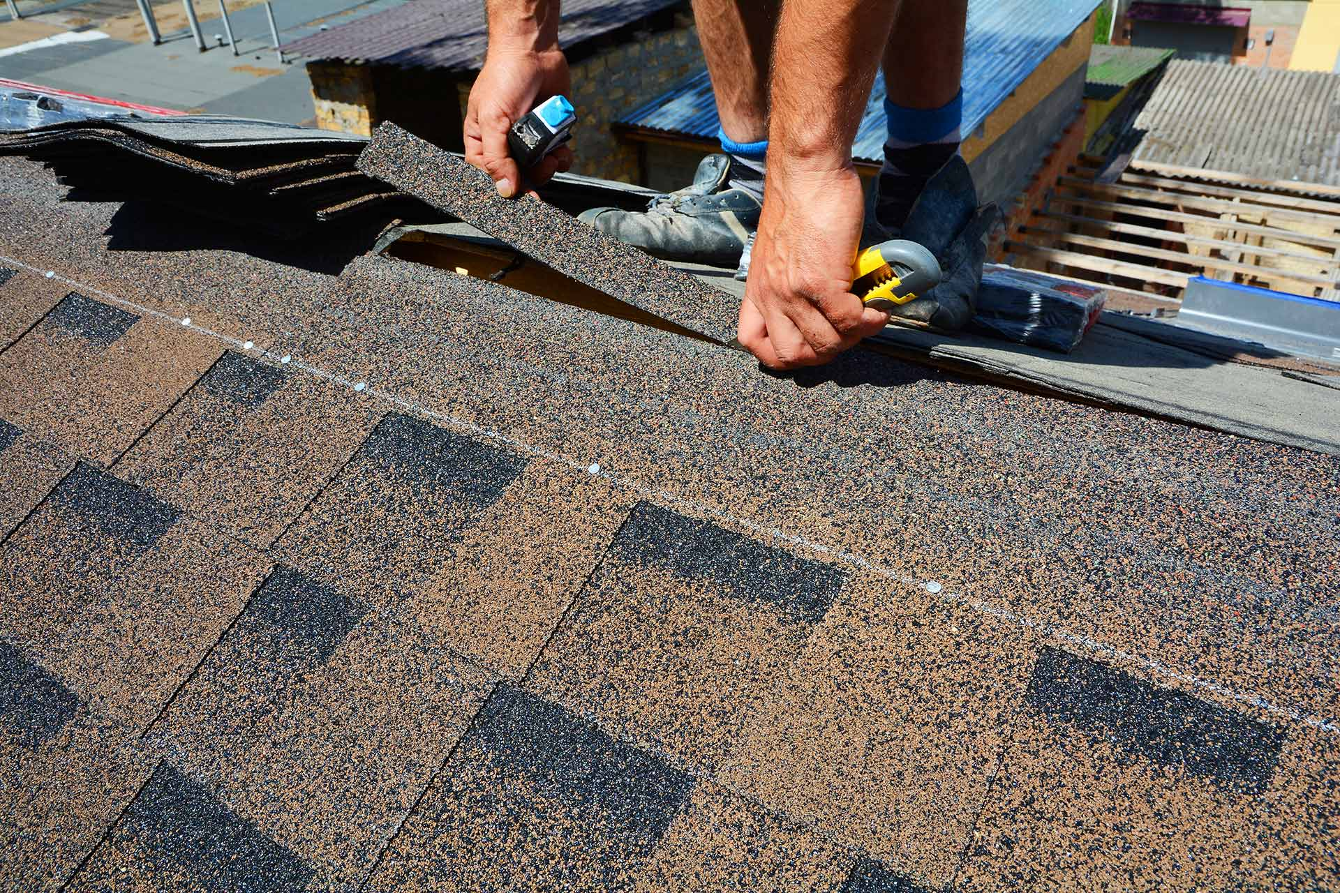 A True Roofers worker repairing shingles on a Wesley Chapel, FL.