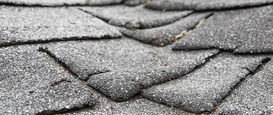 Worn and aged roof shingles on a home in Plant City, Florida.