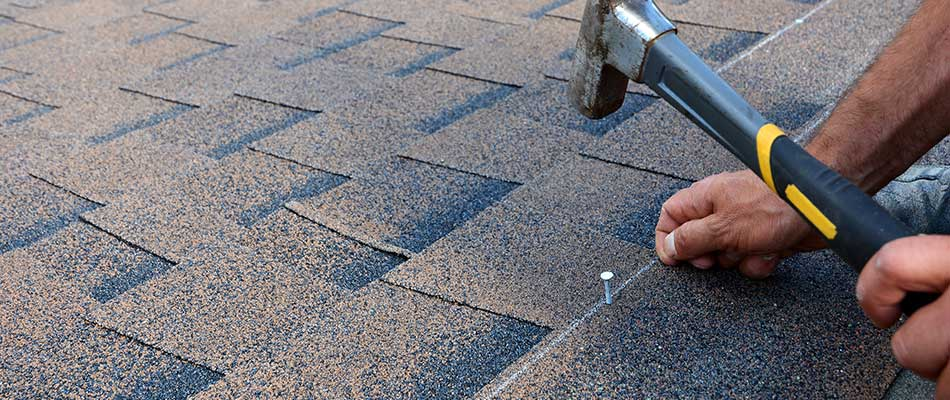 Roofing shingles being repaired at a Lakeland, FL home.